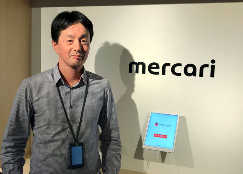 © Reuters. Mercari CEO Shintaro Yamada poses for a photograph during an interview with Reuters in Tokyo