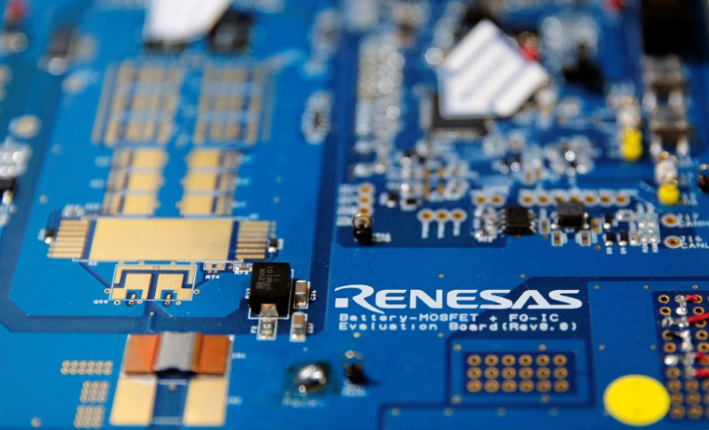 © Reuters. Renesas Electronics Corp's logo is seen on its substrate at the company's conference in Tokyo