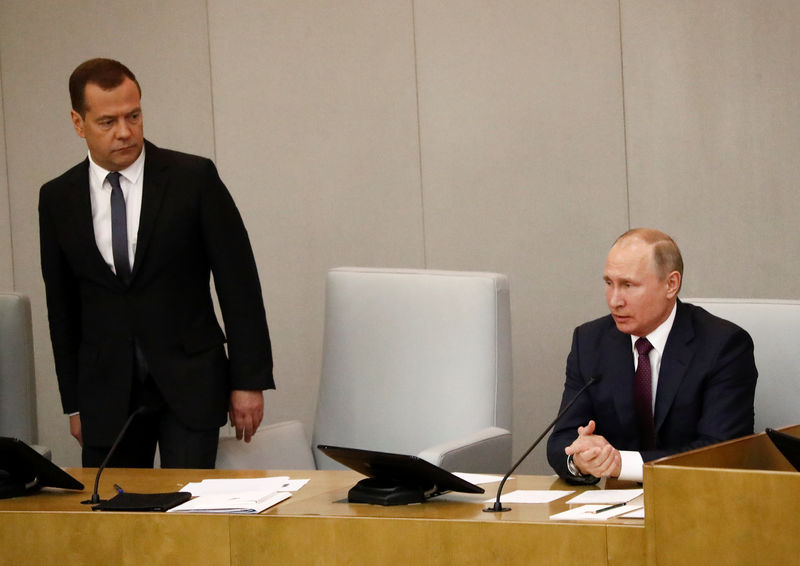 © Reuters. FILE PHOTO: Russian President Putin and Prime Minister Medvedev attend a session of the State Duma in Moscow