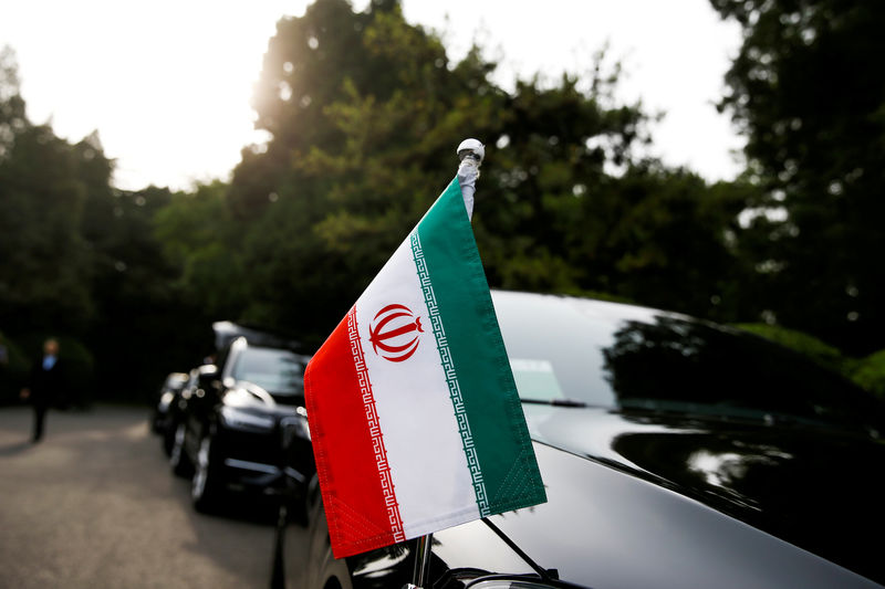 © Reuters. FILE PHOTO: Cars of the Iranian delegation are seen parked outside a building of the Diaoyutai state guesthouse as Iranian Foreign Minister Mohammad Javad Zarif meets Chinese State Councillor and Foreign Minister Wang Yi in Beijing