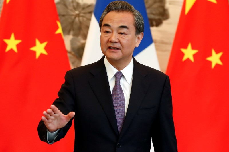 © Reuters. FILE PHOTO - China's State Councilor and Foreign Minister Wang Yi gestures during a signing ceremony in Beijing, China