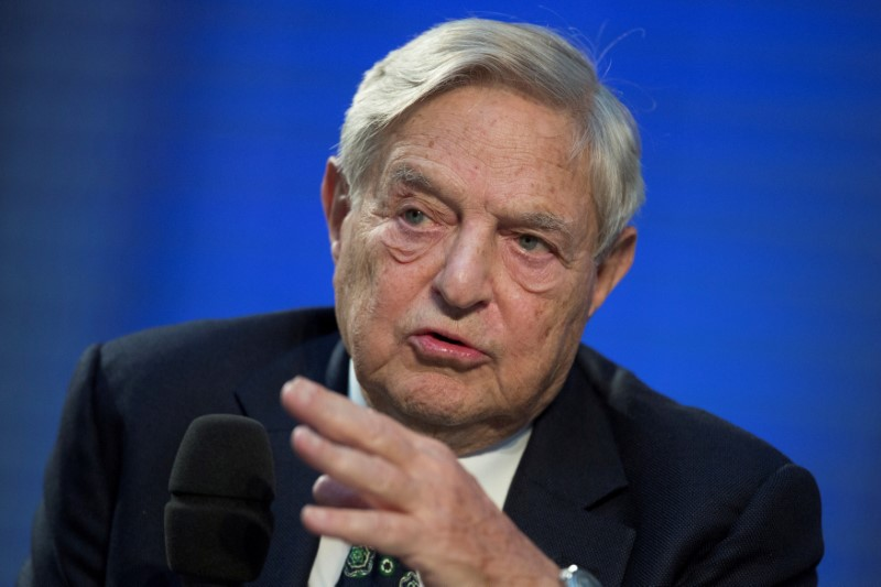 © Reuters. FILE PHOTO: Soros Fund Management Chairman Soros speaks during panel discussion at Nicolas Berggruen Conference in Berlin