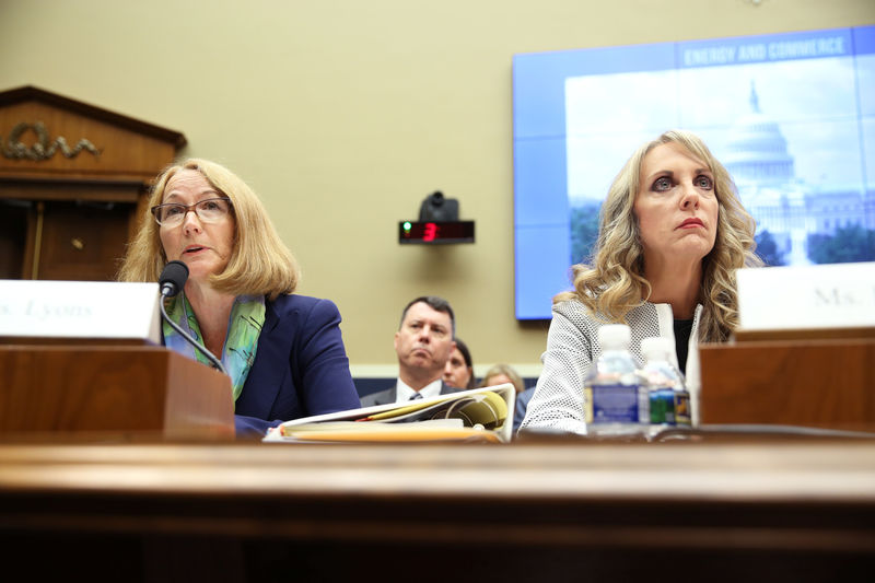 © Reuters. USOC acting chief Susanne Lyons and USA Gymnastics CEO Kerry Perry testify at a House Energy and Commerce Committee hearing on Olympic athletes and sexual abuse on Capitol Hill in Washington