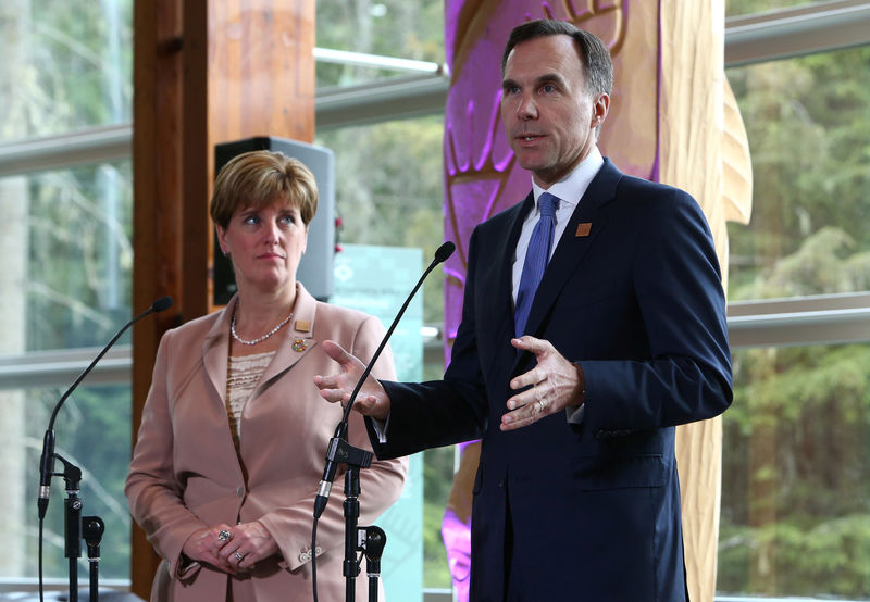 © Reuters. Canada's Minister of Finance Bill Morneau and Minister of International Development Marie-Claude Bibeau speak to media during the G7 Finance Ministers Summit in Whistler