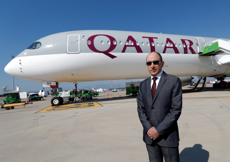 © Reuters. Qatar Airways Chief Executive Officer Akbar al-Baker poses in front of an Airbus A350-1000 at the Eurasia Airshow in the Mediterranean resort city of Antalya