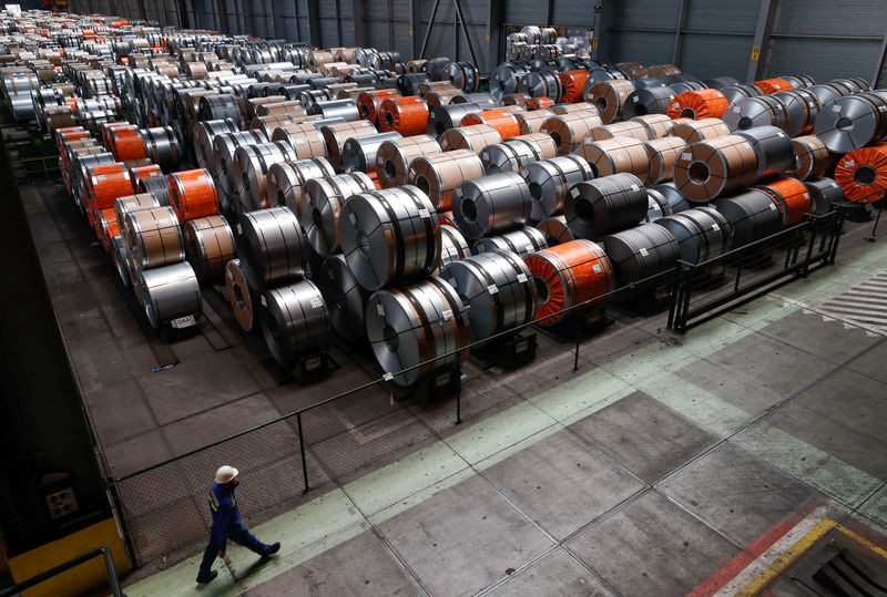 © Reuters. FILE PHOTO: Metal coils are seen at ArcelorMittal steel plant in Ghent