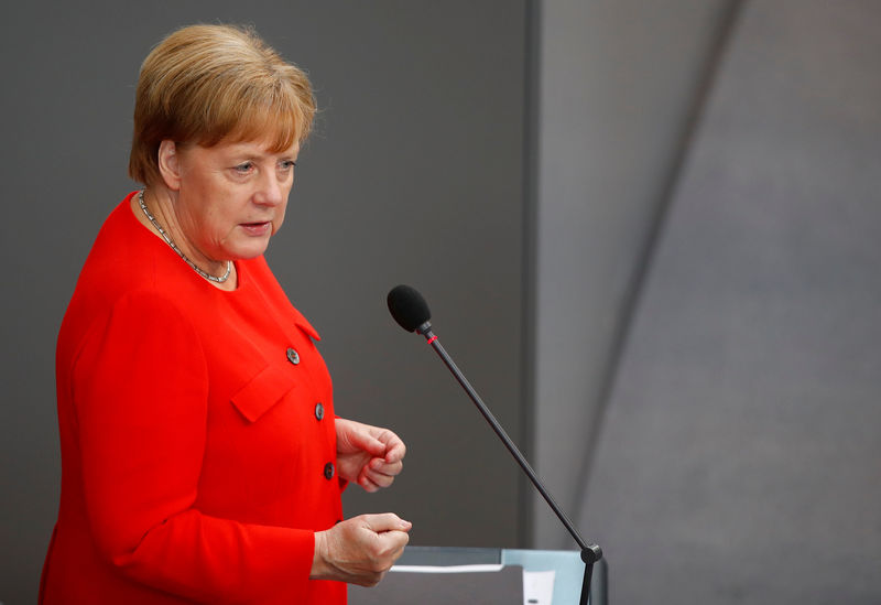 © Reuters. German Chancellor Angela Merkel gestures during a session at the lower house of parliament Bundestag in Berlin