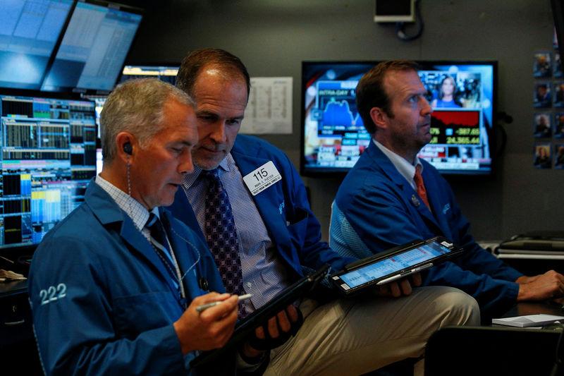 Wall Street rises on economic data, easing trade worries