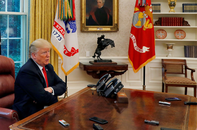 © Reuters. U.S. President Trump answers question as eight devices record him during interview with Reuters in Oval Office of White House in Washington