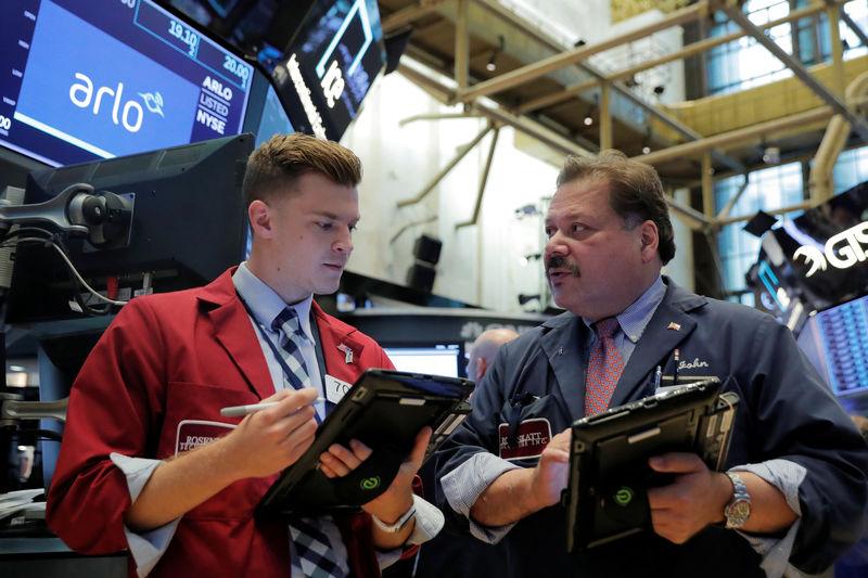 Un S&P-500 record à Wall Street, Trump fait baisser le dollar