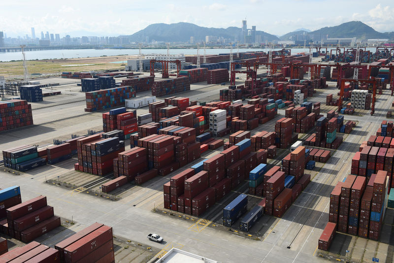 © Reuters. FILE PHOTO: Shipping containers are seen stacked at the Dachan Bay Terminals in Shenzhen