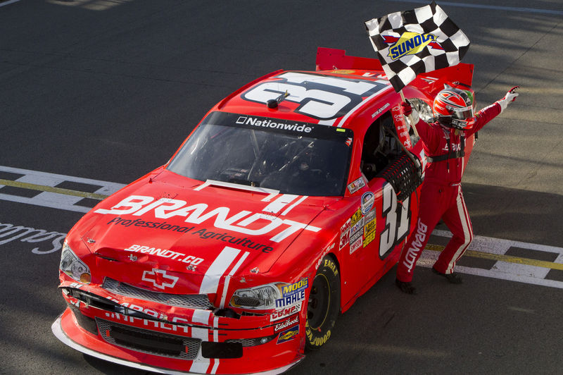 © Reuters. Driver Justin Allgaier celebrates after winning NAPA Auto Parts 200 Nationwide Series NASCAR race in Montreal.