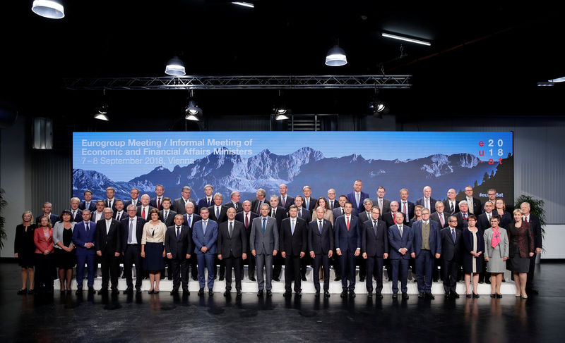 © Reuters. Eurozone and European Union and Ministers and Central Bank Governors pose for a family photo during an informal meeting of economic and financial affairs ministers in Vienna