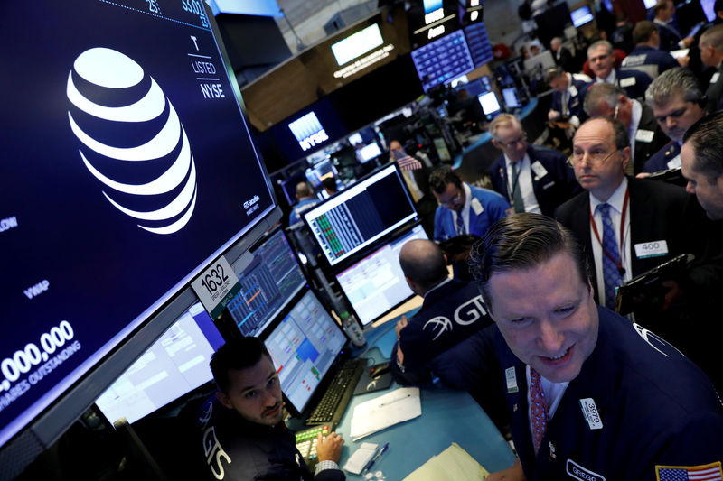 © Reuters. FILE PHOTO: FILE PHOTO: The AT&T logo is seen on a monitor on the NYSE floor.