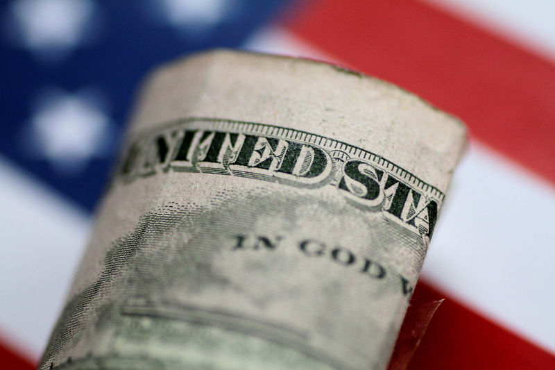 © Reuters. FILE PHOTO: Illustration photo of a U.S. five dollar note