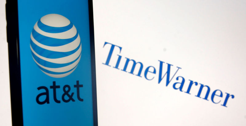 © Reuters. FILE PHOTO: Smartphone with AT&T logo is seen in front of displayed Time Warner logo in this picture illustration