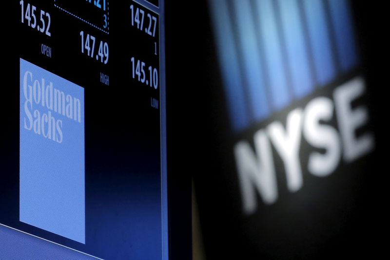 © Reuters. FILE PHOTO: A screen displays the ticker symbol and information for Goldman Sachs on the floor of the New York Stock Exchange