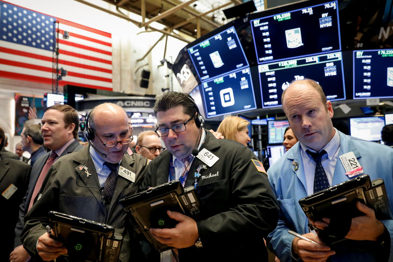 Wall St. slips as IBM disappoints; Fed minutes awaited