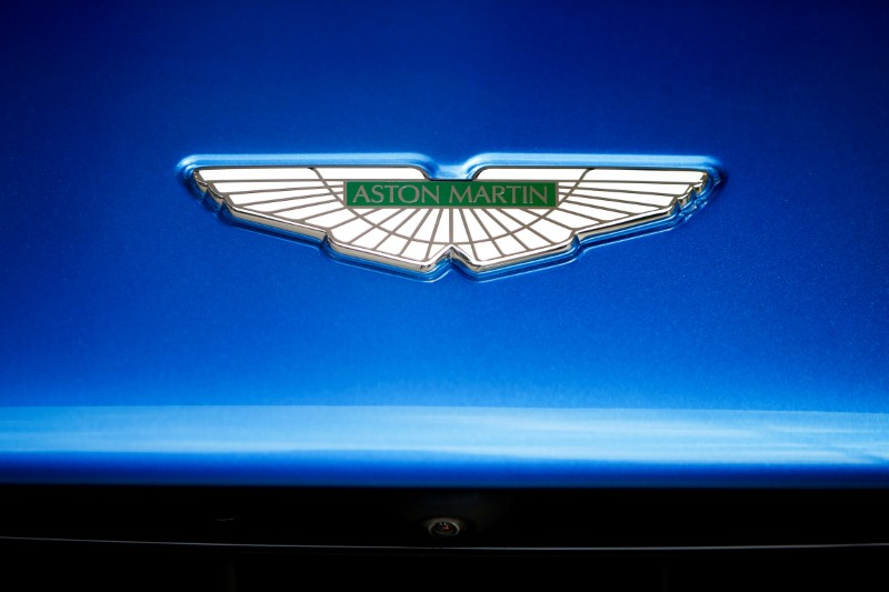 © Reuters. FILE PHOTO: An Aston Martin logo is seen on a car at a dealership in central London