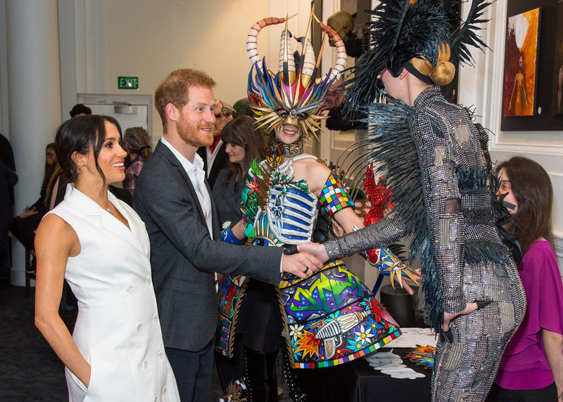 © Reuters. Britain's Prince Harry and Meghan, Duchess of Sussex, meet actors in costumes during a visit to Courtenay Creative, in Wellington
