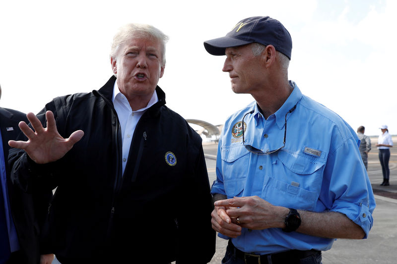 © Reuters. FILE PHOTO: President Trump is greeted as he arrives for tour of Hurricane Michael storm damage at Eglin Air Force Base Florida
