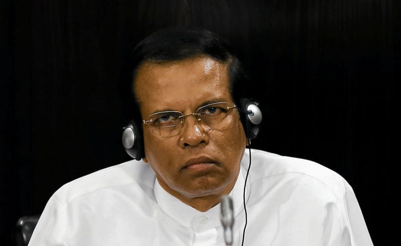 © Reuters. FILE PHOTO: Sri Lanka's President Maithripala Sirisena listens to a speech during a Parliament session marking the 70th anniversary of Sri Lanka's Government, in Colombo