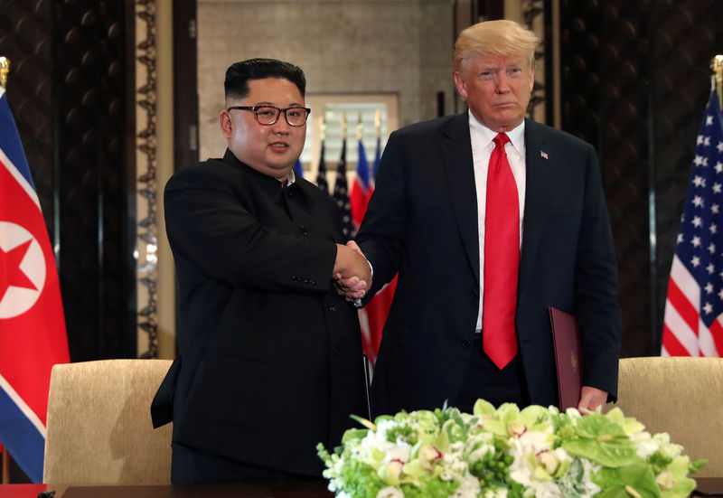 © Reuters. FILE PHOTO: U.S. President Donald Trump shakes hands with North Korea's leader Kim Jong after signed documents, after their summit in Singapore