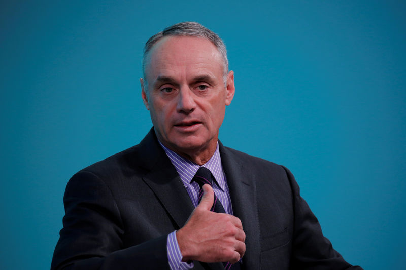 © Reuters. FILE PHOTO: Rob Manfred, commissioner of Major League Baseball, takes part in the Yahoo Finance All Markets Summit in New York