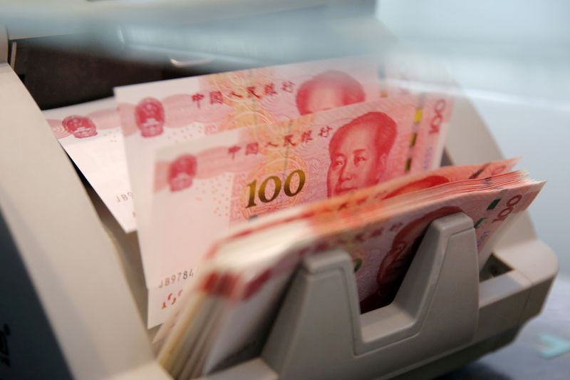 China state banks seen selling dollars in FX market to arrest yuan losses: traders