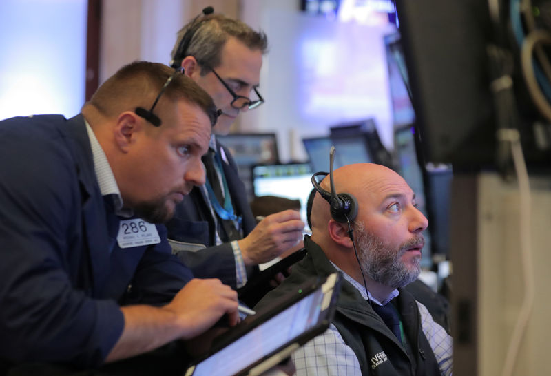 Wall Street gains on tech bounce, trade hopes