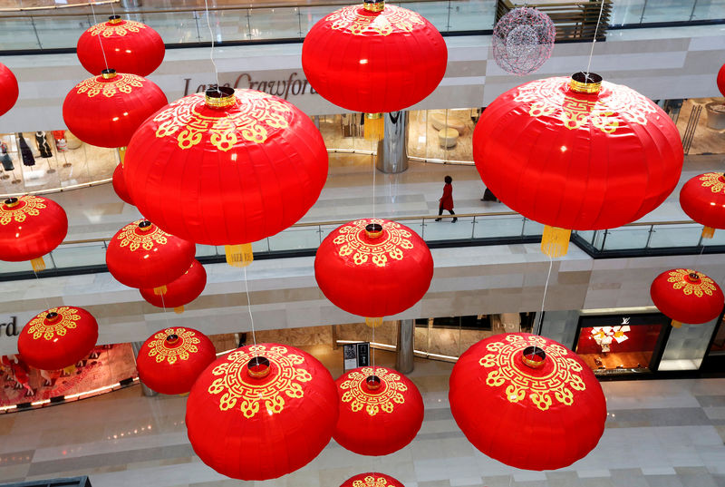 China's stay-at-home shoppers propel luxury sales: Bain