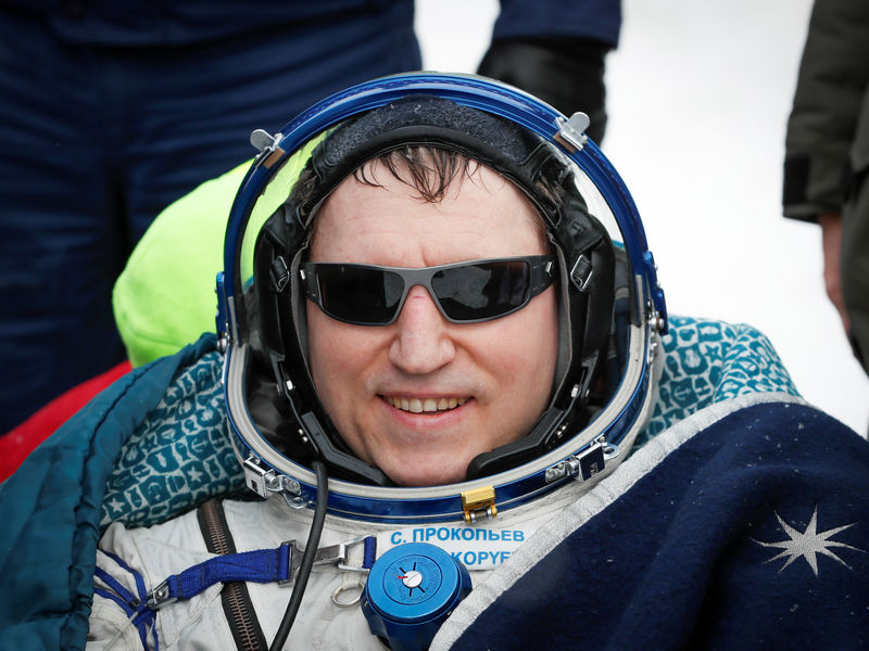 © Reuters. International Space Station crew member Prokopyev rests after landing near Zhezkazgan
