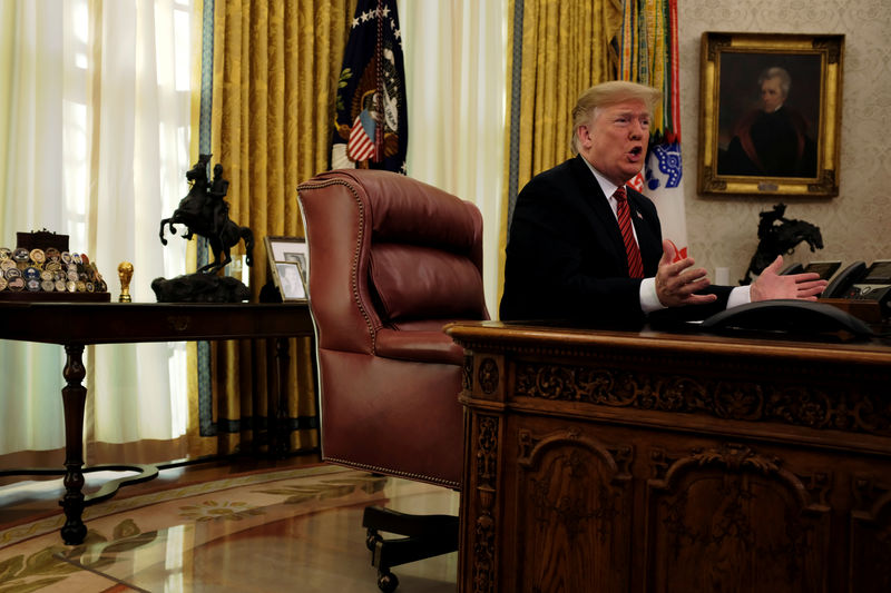 © Reuters. FILE PHOTO: U.S. President Donald Trump speaks with reporters after holding a video call with U.S. military service members in the Oval Office on Christmas morning in Washington