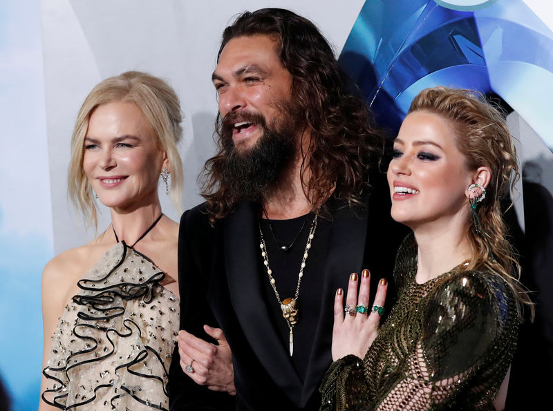 © Reuters. Cast members Momoa, Kidman and Heard pose at the premiere for