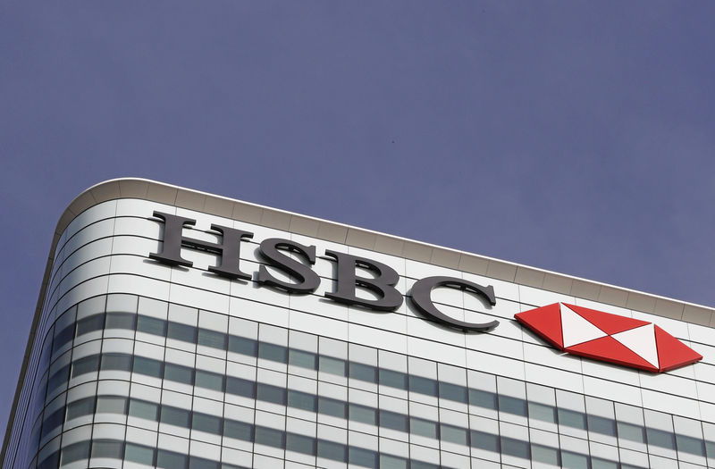 © Reuters. The HSBC logo is seen at their offices at Canary Wharf financial district in London
