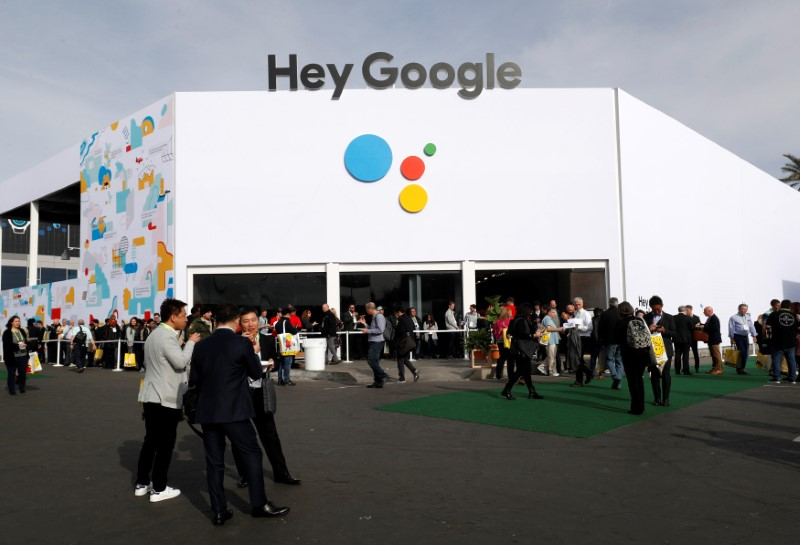 © Reuters. People line up outside the Hey Google booth during the 2019 CES in Las Vegas