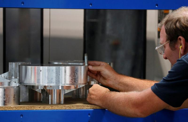 © Reuters. Worker examines an aluminium component inside Produmax in Shipley