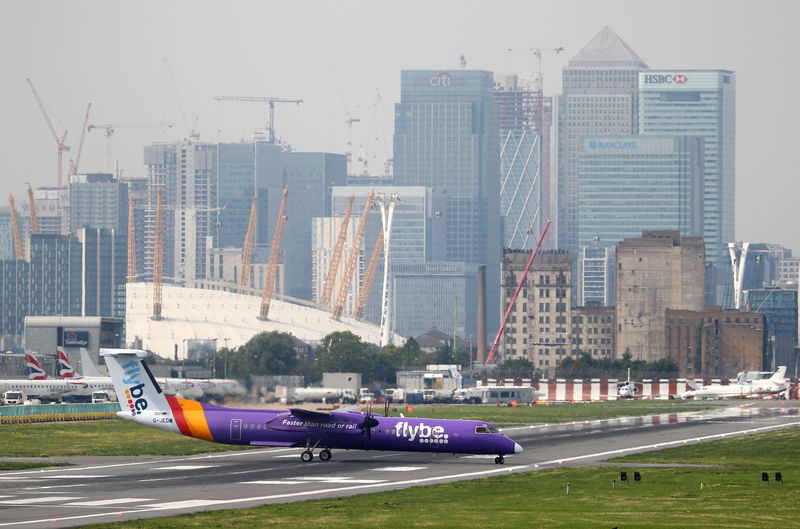 © Reuters. FILE PHOTO: A Flybe Bombardier Dash 8 Q400 airplane taxis at City Airport in London