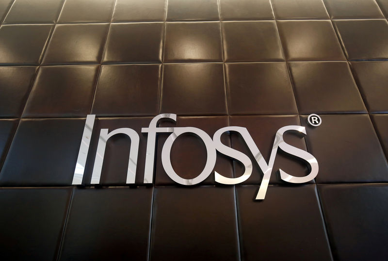 © Reuters. FILE PHOTO - The logo of Infosys is pictured inside the company's headquarters in Bengaluru