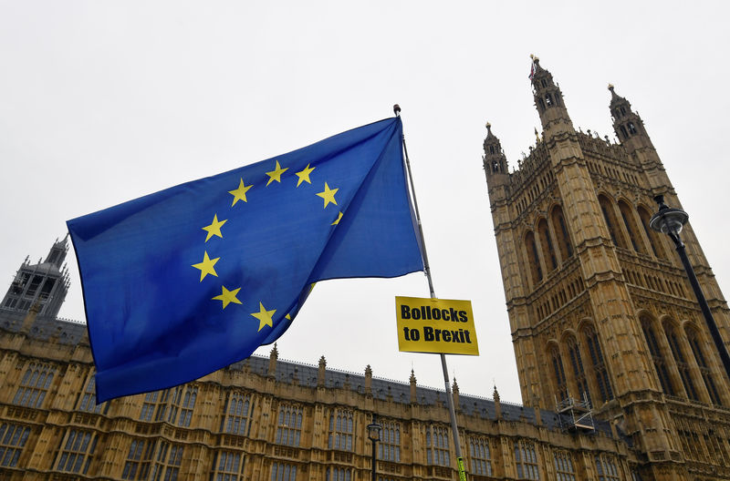 © Reuters. An EU flag with an anti-Brexit banner is flown outside of the Houses of Parliament in London, Britain