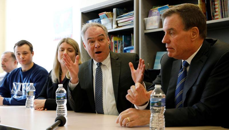 © Reuters. Senators Warner and Kaine meet with furloughed workers in Alexandria Virginia