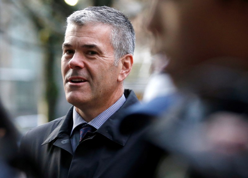 © Reuters. FILE PHOTO: Huawei Canada Vice President of Corporate Affairs Bradley stands outside after the B.C. Supreme Court bail hearing of Huawei CFO Meng in Vancouver