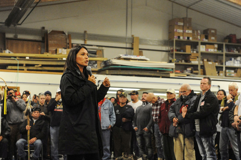 "© Reuters. FILE PHOTO: Gabbard, speaks to veterans at a Sioux tribal welcome meeting at Sitting Bull College as ""water protectors"" continue to demonstrate against plans to pass the Dakota Access pipeline near the Standing Rock Indian Reservation, in Fort Y"
