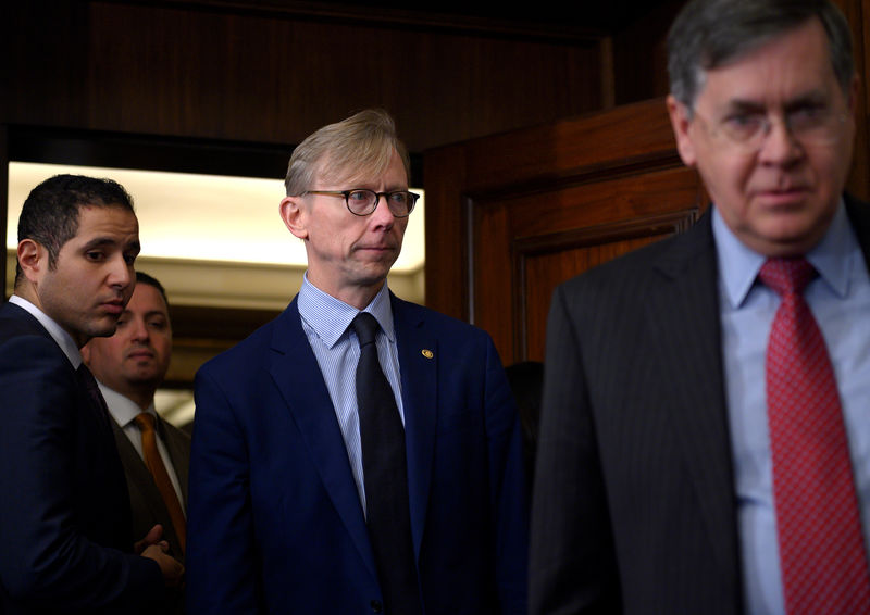 © Reuters. FILE PHOTO: Brian Hook, the U.S. Special Representative for Iran (centre), arrives for a news conference in Cairo