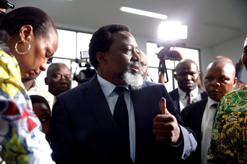 © Reuters. LA COALITION PRO-KABILA RESTE MAJORITAIRE AU PARLEMENT