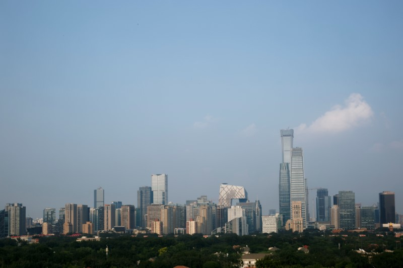 © Reuters. FILE PHOTO: The skyscrapers of the Central Business District rise behind the capital's embassy neighbourhood in Beijing