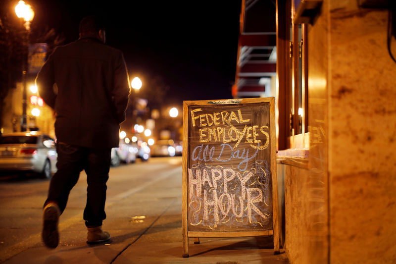 © Reuters. FILE PHOTO: A sign is displayed at a local bar during the partial U.S. government shutdown in Washington