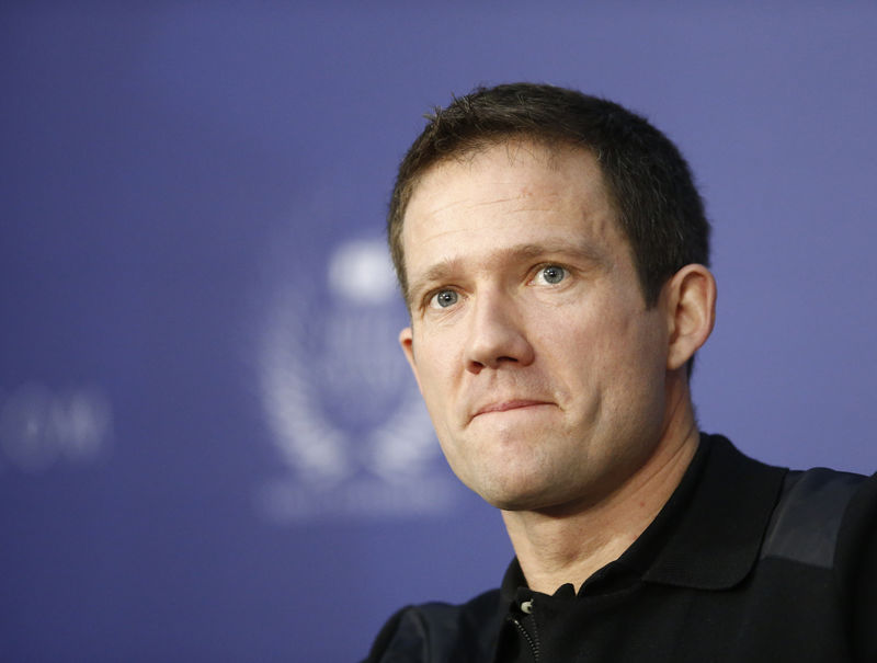 © Reuters. World Rally Champion Ogier listens during the FIA news conference in St. Petersburg
