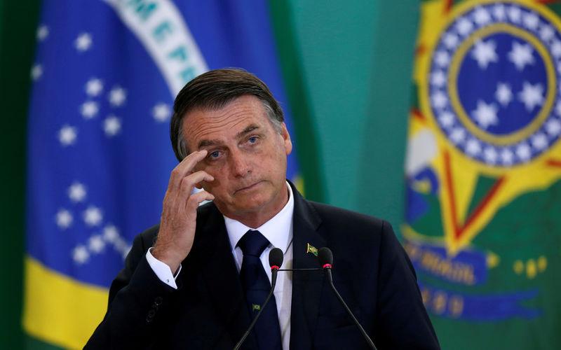 © Reuters. FILE PHOTO: Brazil's President Bolsonaro attends ceremony at Planalto Palace in Brasilia