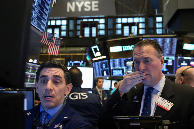 Stock futures lower on global growth worries after IMF trims outlook